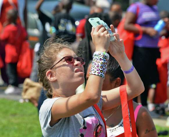 Meghan Penman, 13, uses her smart phone to record activities during the WORDS Summer of Kindness anti-bullying campaign event at CrossFit Beyond Friday August 14, 2015 in Albany, NY.  .(John Carl D'Annibale / Times Union) Photo: John Carl D'Annibale / 00033006A