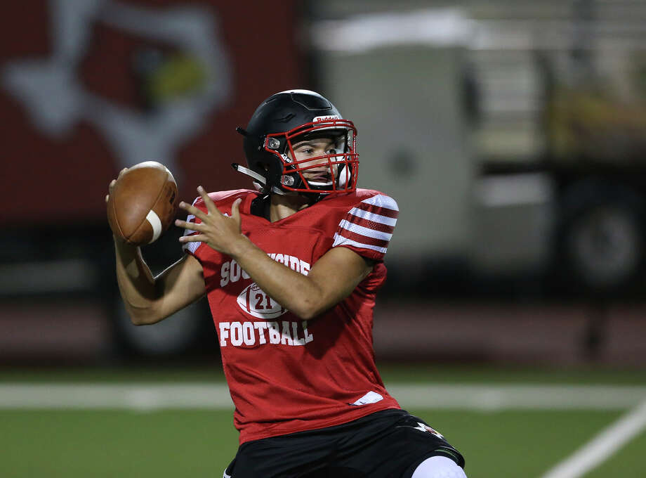 The passing game is worked on during the first part of the workout as the Southside Cardinals hold football practice in their stadium a starting at midnight on Friday, August 14, 2015. Photo: Tom Reel, San Antonio Express-News