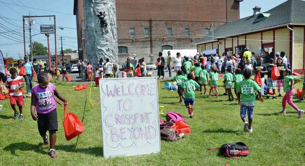 Some 250 local children attend the WORDS Summer of Kindness event at CrossFit Beyond Friday August 14, 2015 in Albany, NY.  .(John Carl D'Annibale / Times Union) Photo: John Carl D'Annibale / 00033006A