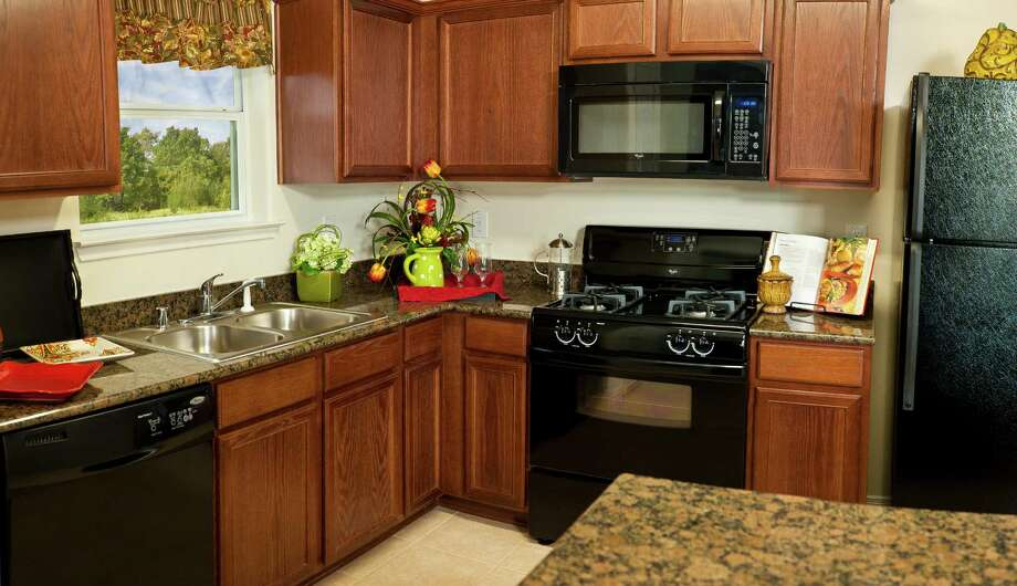 New homes at Panther Oaks feature custom built cabinets, new kitchen appliances and granite countertops.