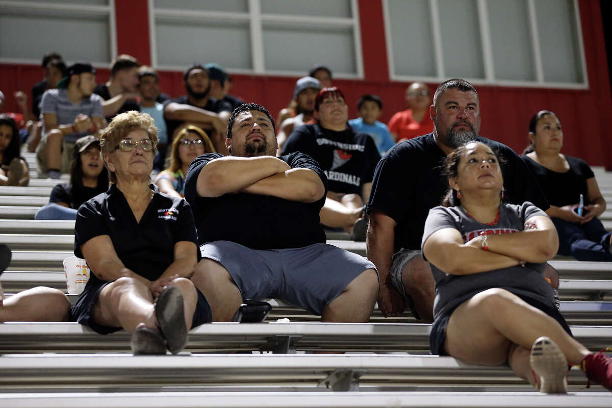 Fans take in the sights of the new team as the Southside Cardinals hold football practice in their stadium a starting at midnight on Friday, August 14, 2015.