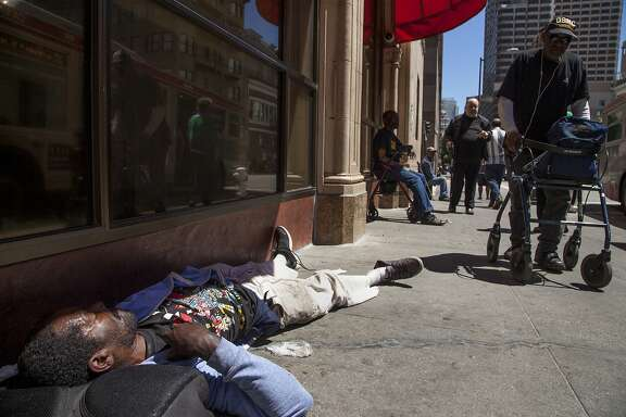 Andre Pierre Thurston sleeps outside the Glide Memorial Church, Friday, Aug. 14, 2015, in San Francisco, Calif.