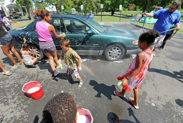 Children from a Boys and Girls Club summer program washed cars and sold lemonade to raise money to fix up Steinmetz Park in Schenectady's Goose Hill neighborhood on Friday Aug. 14, 2015 in Schenectady, N.Y.  (Michael P. Farrell/Times Union) Photo: Michael P. Farrell / 00033007A