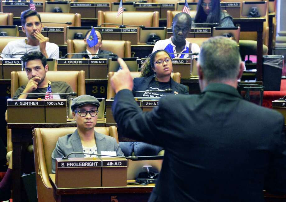 Assemblyman John McDonald, right, addresses LGBTactivists from around the world during their visit to Albany and the State Capitol Friday August 14, 2015 in Albany, NY.  (John Carl D'Annibale / Times Union) Photo: John Carl D'Annibale / 00033014A