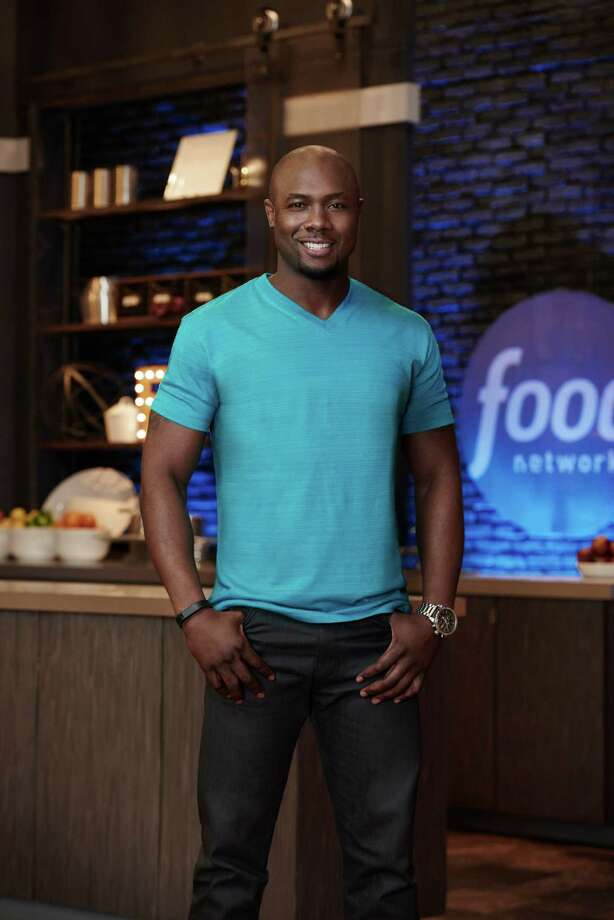 "Houston's Eddie Jackson (who owns a private fitness gym in Cypress) is among the top three finalists on Food Network's ""Food Network Star."" The show's finale will be broadcast Aug. 16. Finalist Eddie Jackson, as seen on Food Network Star, Season 11. Photo: Food Network, Comissioned Photographer / © 2014, Television Food Network, G.P. All Rights Reserved"