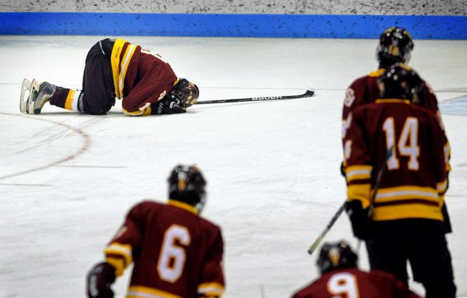 St. Joseph's Pat Corcoran puts his head down on the ice following his team's loss to Amity in the Division II Finals Friday Mar. 19, 2010 at Ingalls Rink in New Haven. Photo: Autumn Driscoll / Connecticut Post