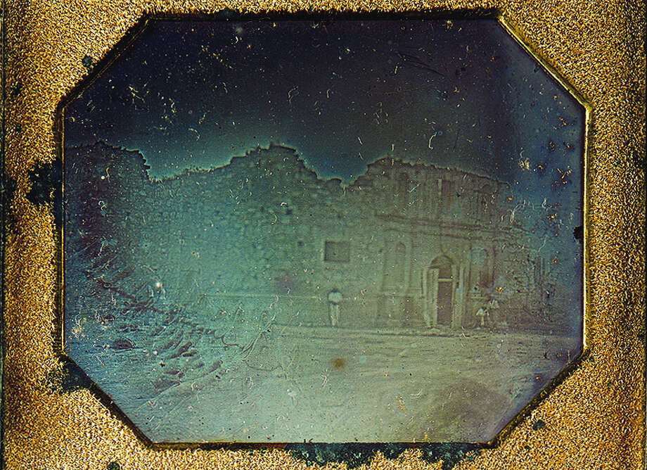 The 1849 daguerreotype is the earliest datable photograph taken in Texas. It shows the front of the Alamo chapel. It is the only known photograph of the Alamo taken before the 1850 reconstruction that added the distinctive curved gable to the top of the church facade. Photo: Briscoe Center For American History