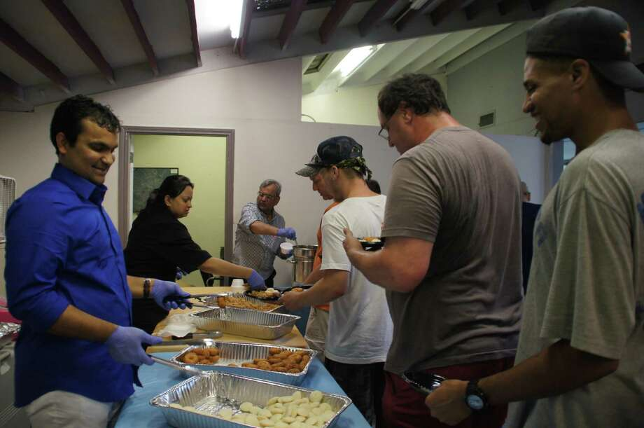 DGN Factory owner Niraj (Nic) Shah serving food at Magnificat House for his 33rd birthday