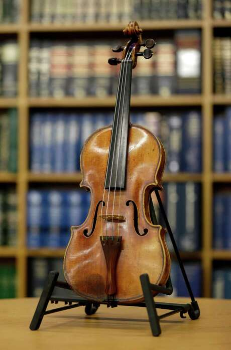 Philip Johnson, a concert violinist who died in 2011, was the only suspect in the theft of Roman Totenberg's Ames Stradivarius violin. Photo: Seth Wenig, STF / AP