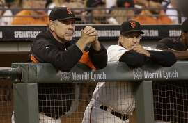 San Francisco Giants manager Bruce Bochy, left, and bench coach Ron Wotus watch from the dugout during a baseball game against the Milwaukee Brewers in San Francisco, Tuesday, July 28, 2015. (AP Photo/Jeff Chiu)