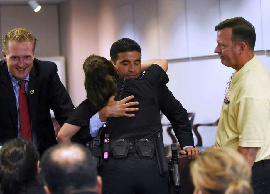 District attorney Nico LaHood embraces Selma Police Officer Tiffany Kierum, who was shot in the face by Jessie Hernandez Jr., after Hernandez was sentenced to life in prison in 437th State District Court on Friday, Aug. 14, 2015. Photo: Billy Calzada, San Antonio Express-News / San Antonio Express-News
