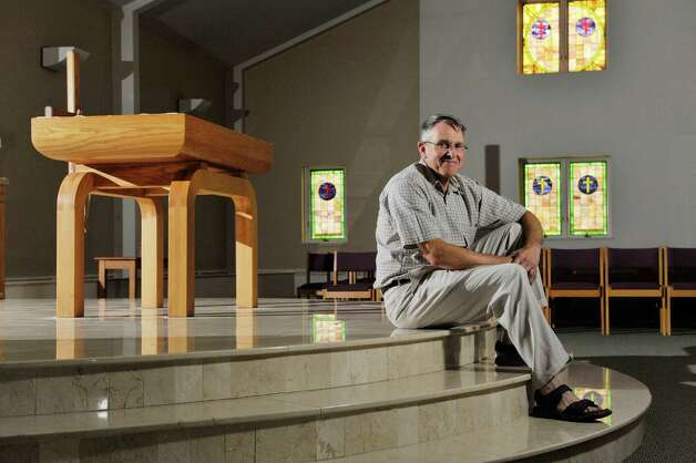 Father Chris DeGiovine, pastor at St. Matthew's Church, poses for a photograph in the sanctuary on Wednesday, Aug. 5, 2015, in Voorheesville, N.Y.  (Paul Buckowski / Times Union) Photo: PAUL BUCKOWSKI / 10032855A