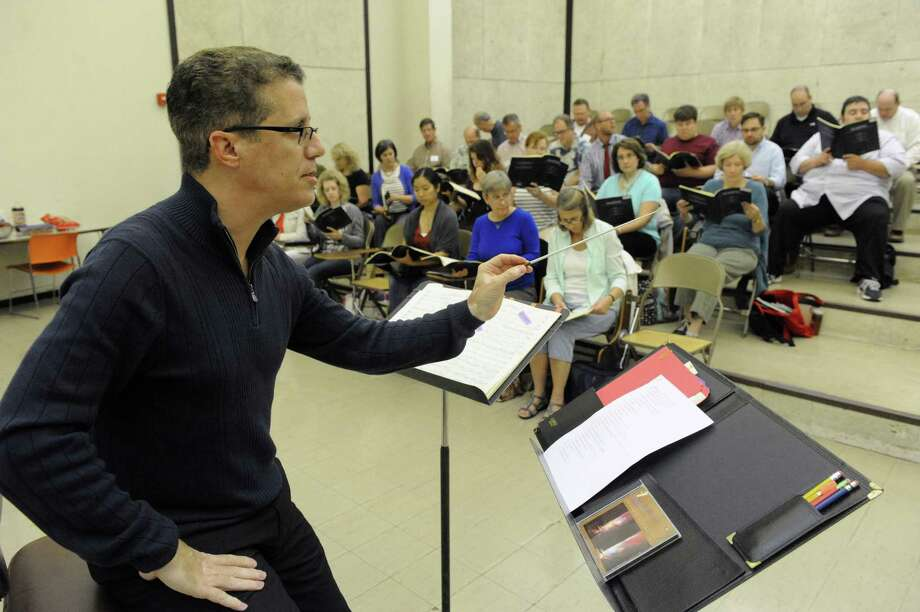 Jose-Daniel Flores, the new artistic director/conductor of Albany Pro Musica, leading a rehearsal at UAlbany on Tuesday Sept. 30, 2014 in Albany, N.Y.  (Michael P. Farrell/Times Union) Photo: Michael P. Farrell / 00028718A