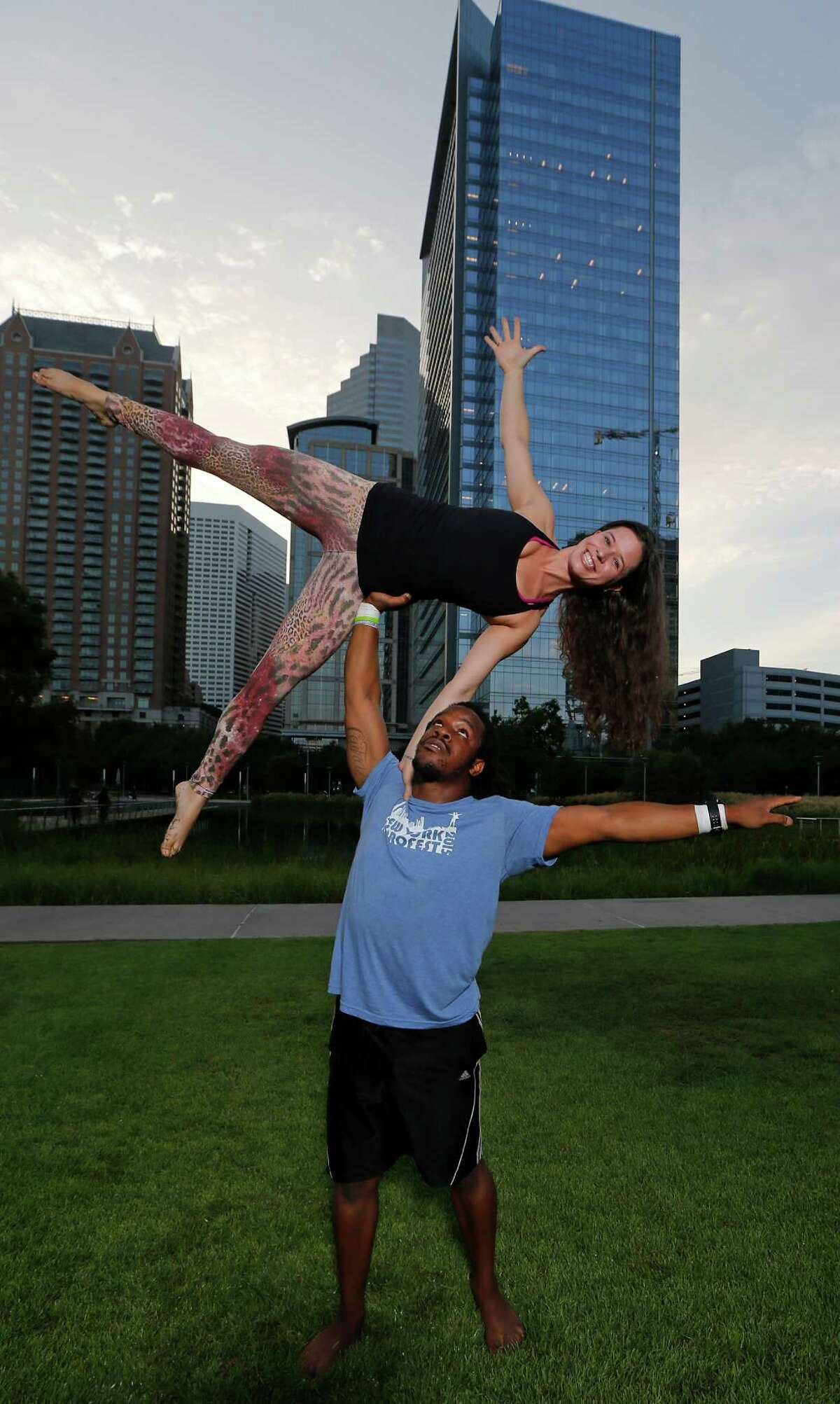 Acroyoga instructors Nosa bottom, and his wife Susie Edebor pose for a portrait at Discovery Green where they teach classes Tuesday, Aug. 4, 2015, in Houston. ( James Nielsen / Houston Chronicle )