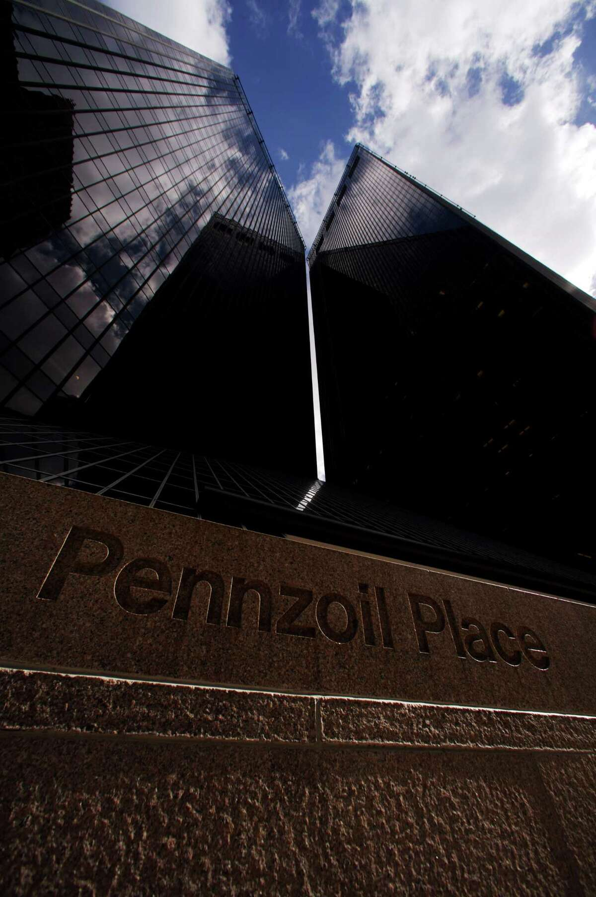 Pennzoil Place: Completed in 1975, the project, two 36-story trapezoidal towers of dark bronze-tinted glass connected by a glass-enclosed courtyard, was designed by Philip Johnson and John Burgee. (Jim Olive Photography)