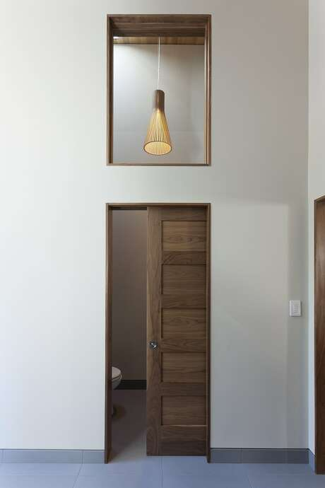Jeni Gamble's pick for bathroom doors: space-saving pocket doors with lockable hardware by Linnea. Photo: Gamble + DESIGN