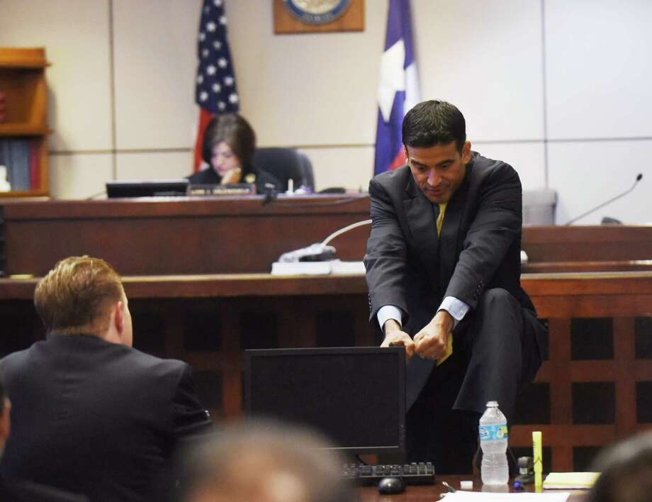 District Attorney Nico LaHood mimicks how hard it was to pull an apology out of defendant Jessie Hernandez Jr., during closing arguments of the sentencing phase in 437th State District Court in Hernandez's trial for the shooting of Officer Tiffany Kierum, on Friday. Photo: Billy Calzada /San Antonio Express-News / San Antonio Express-News