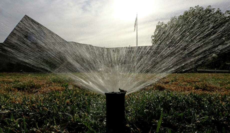 Lawn watering could be limited to one day a week throughout the year under a plan policymakers are considering. Photo: Associated Press File Photo / AP