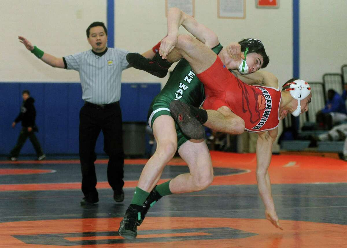New Milford's Kyle Lindner takes down Greenwich's Alex Margetoes in the 113-pound division of the wrestling match between between New Milford and Greenwich as part of the meet between Danbury, New Milford, Greenwich, Darien, Xavier and Harding at Danbury High School in Danbury, Conn. on Saturday, Feb. 8, 2014.