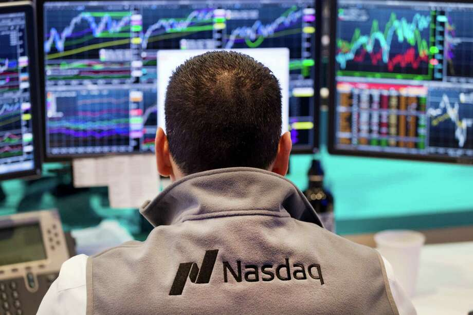 FILE - In this April 16, 2015 file photo, a Nasdaq employee monitors prices at the Nasdaq MarketSite, in New York. The tech-driven Nasdaq hit another in a string of all-time highs last month as technology re-established itself as the dominant sector in the U.S. stock market, harking back to its last heyday during the Internet boom of the late 1990s. (AP Photo/Mark Lennihan, File) ORG XMIT: NYBZ201 Photo: Mark Lennihan / AP