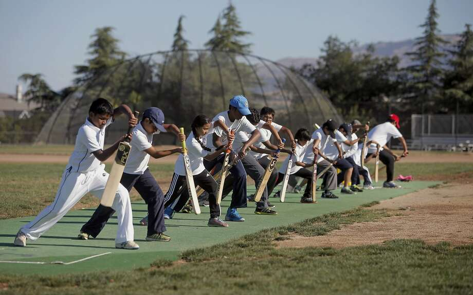 Batters line up for training as children practice their cricket skills during summer vacation at  Windemere Ranch Middle school in San Ramon, Calif., on Fri. August 14,  2015. Photo: Michael Macor, The Chronicle