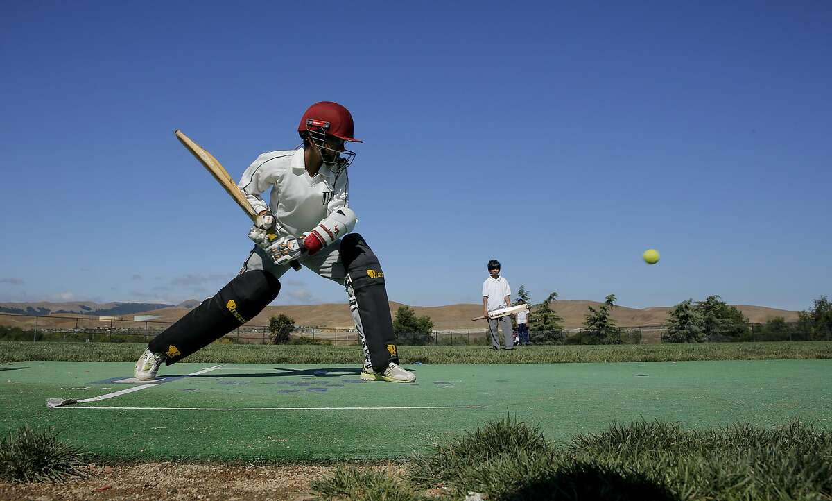 Shamith Pasula, 11 is dressed in full gear as he takes his stance joining other children practicing their cricket skills during summer vacation at Windemere Ranch Middle school in San Ramon, Calif., on Fri. August 14, 2015.