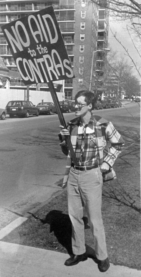 "Stamford resident Martin Hubbe protested against U.S. aid to the Contras counter-revolutionary groups in Nicaragua in April 1985 during a visit by a ""protest caravan"" to Latham Park. Hubbe was a member of the 4th Congressional District Chapter of the Pledge of Resistance. Photo: John Voorhees / Hearst Connecticut Media / Stamford Advocate"