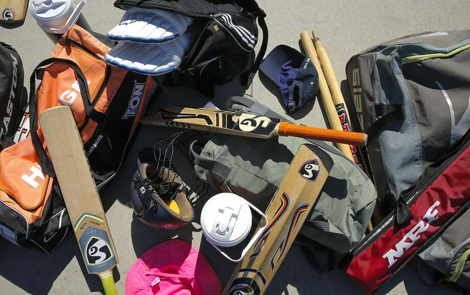 Cricket equipment is at the ready nearby as children practice their batting and bowling skills during summer vacation at the Windemere Ranch Middle school in San Ramon, Calif., on Fri. August 14,  2015. Photo: Michael Macor, The Chronicle