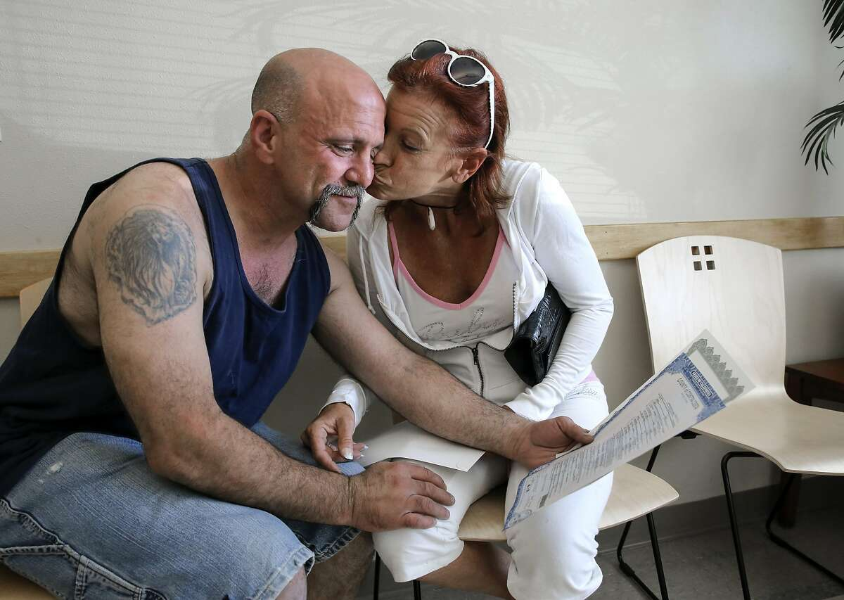 Husband and wife Danny and Nancy Armas of Concord made it official today as they look over the marrige license at the end of their ceremony at the Contra Costa Clerk Recorders office in Martinez, Calif., on Fri. August 14, 2015.
