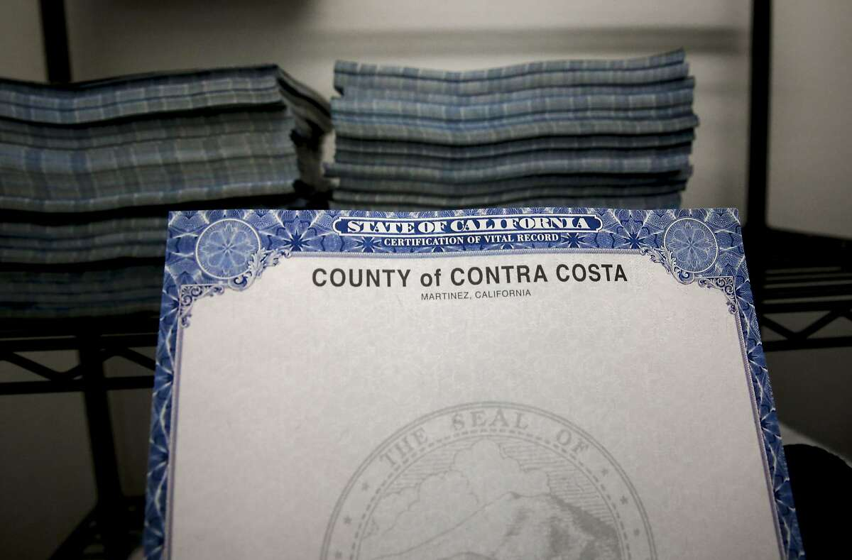 The State of California requires this special type of security-enabled paper be used to print birth and death certificates and marriage licenses, seen stacked in a store room at the Contra Costa Clerk Recorders office in Martinez, Calif., on Fri. August 14, 2015.