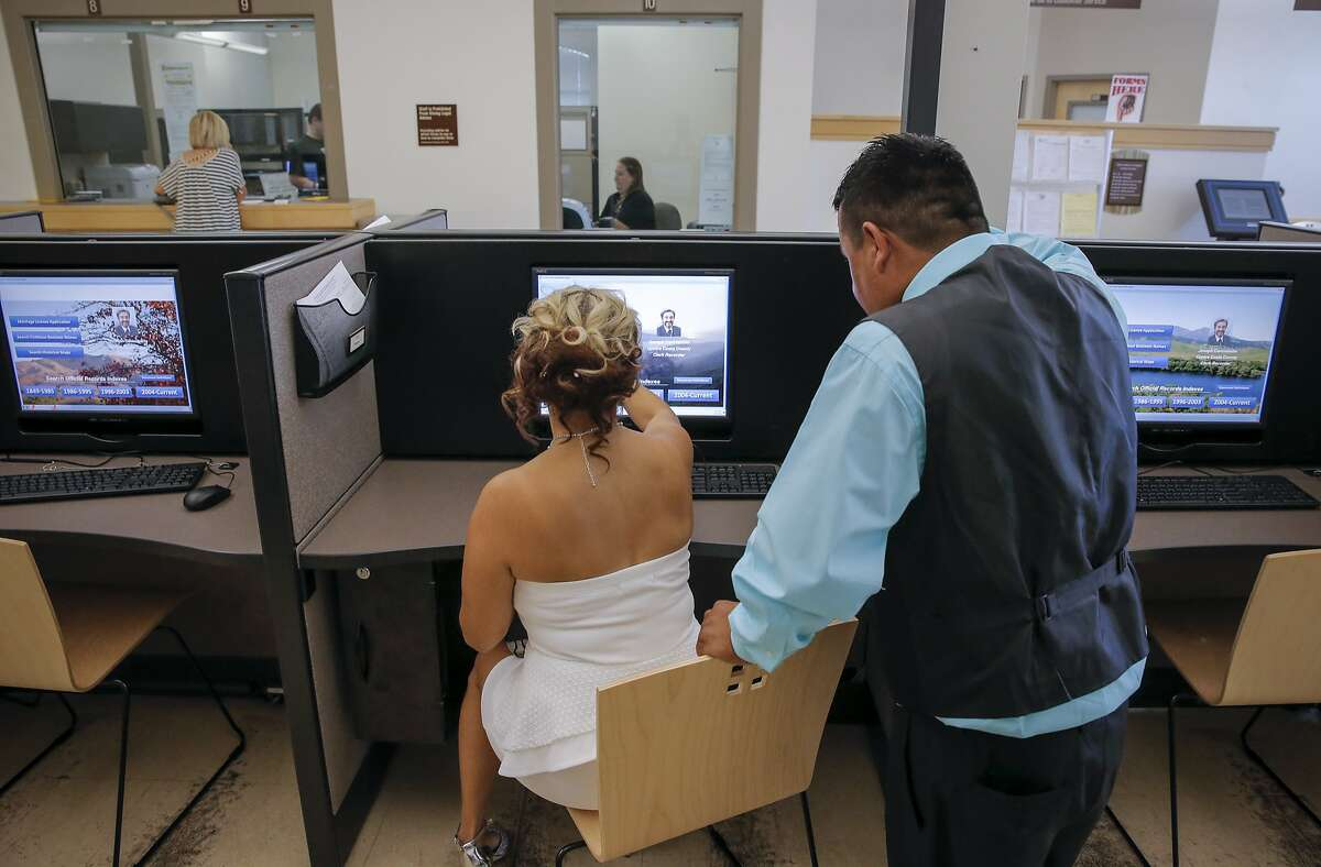 Claudia and Jesus Pantoja, soon to be husband and wife, use the terminals to register for a marriage license at the Contra Costa Clerk-Recorder's Office in Martinez.