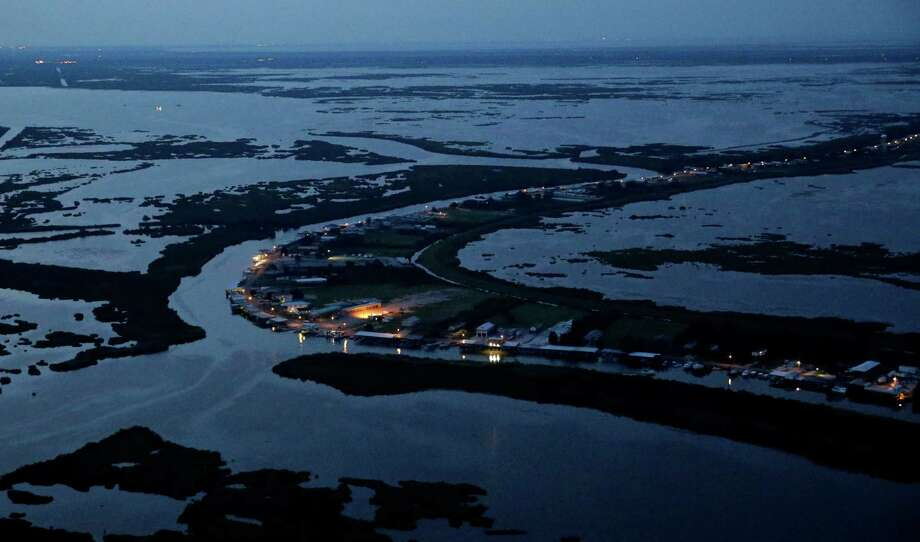 An aerial photo shows Delacroix Island surrounded by eroding marshland and coastal waters in St. Bernard Parish, La. Photo: Gerald Herbert /Associated Press / AP