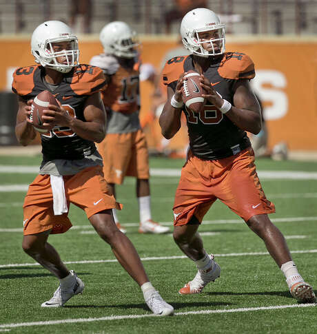 Texas quarterbacks Tyrone Swoopes, right, and Jerrod Heard, left, drop back during drills at an open practice and fan appreciation day at Royal-Memorial Stadium on Aug. 9, 2015. Photo: Ralph Barrera /Austin American-Statesman / Austin American-Statesman
