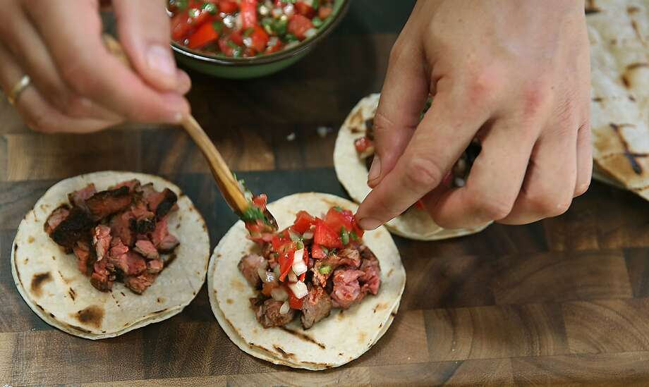 Food writer J. Kenji Lopez-Alt makes tacos from his marinated meats at home in San Mateo. Photo: Liz Hafalia, The Chronicle