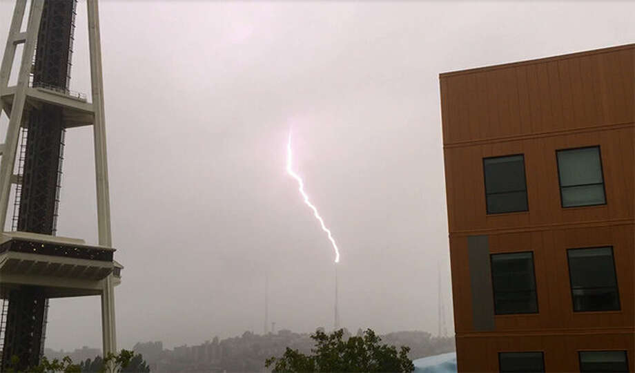 Rain and lighting hit Seattle throughout Friday afternoon, causing power outages and traffic jams during the busy rush hours. Photo: Courtesy KOMO/4