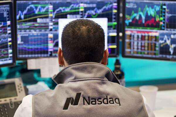 FILE - In this April 16, 2015 file photo, a Nasdaq employee monitors prices at the Nasdaq MarketSite, in New York. The tech-driven Nasdaq hit another in a string of all-time highs last month as technology re-established itself as the dominant sector in the U.S. stock market, harking back to its last heyday during the Internet boom of the late 1990s. (AP Photo/Mark Lennihan, File)