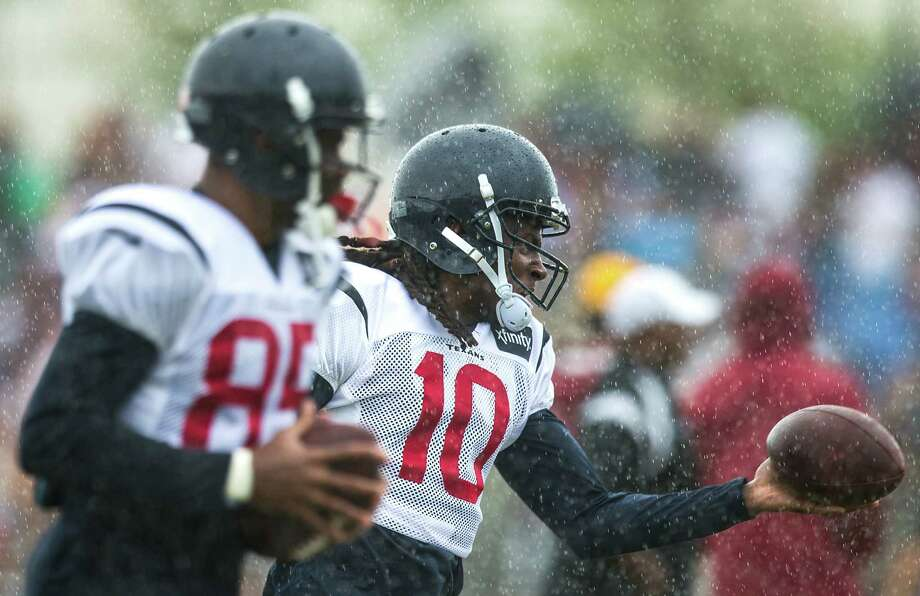 DeAndre Hopkins (10) has a solid grip on the Texans' No. 1 receiver spot while Nate Washington (left) brings veteran savvy in his first season in Houston. ( Brett Coomer / Houston Chronicle ) Photo: Brett Coomer, Staff / © 2015 Houston Chronicle