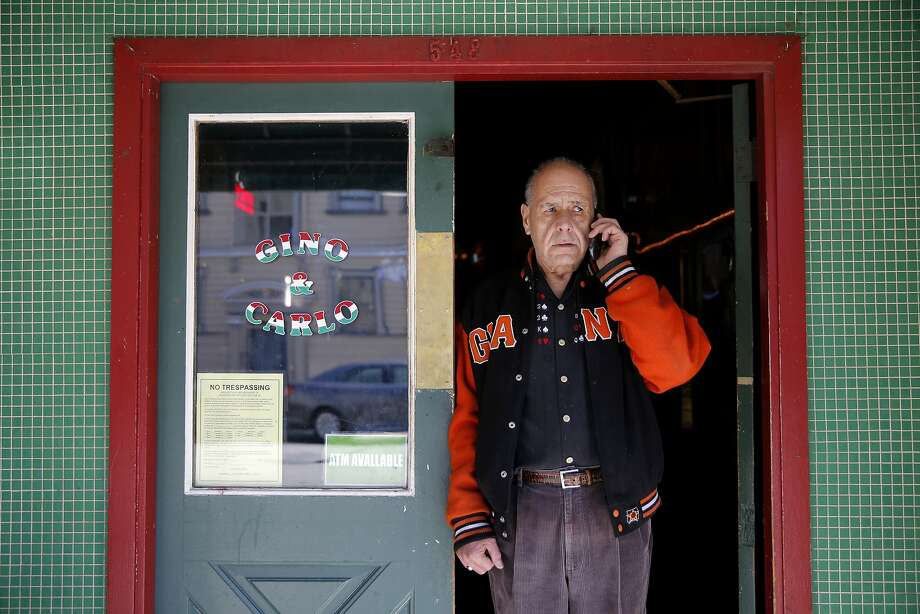 Left: Eighteen- year resident Silvio Manis calco, 68, talks to his daughter on the phone outside Gino and Carlo, where he works part time as a bartender. Photo: Connor Radnovich, The Chronicle