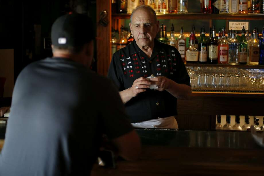 Silvio Maniscalco talks to a bar patron at Gino and Carlo, where he works part time as a bartender, in San Francisco, California, on Thursday, Aug. 13, 2015. Photo: Connor Radnovich, The Chronicle