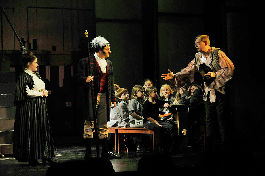 "Mayor David Martin, right, makes a cameo performance as an orphan opposite Rebecca Borowik, far left, playing The Widow Corney, and William Bruno, center, playing Mr. Bumble, at the end of the opening scene of the annual summer youth theatre production of ""Oliver"" at Curtain Call in Stamford, Conn., on Friday, Aug. 14, 2015. Photo: Jason Rearick / Hearst Connecticut Media / Stamford Advocate"