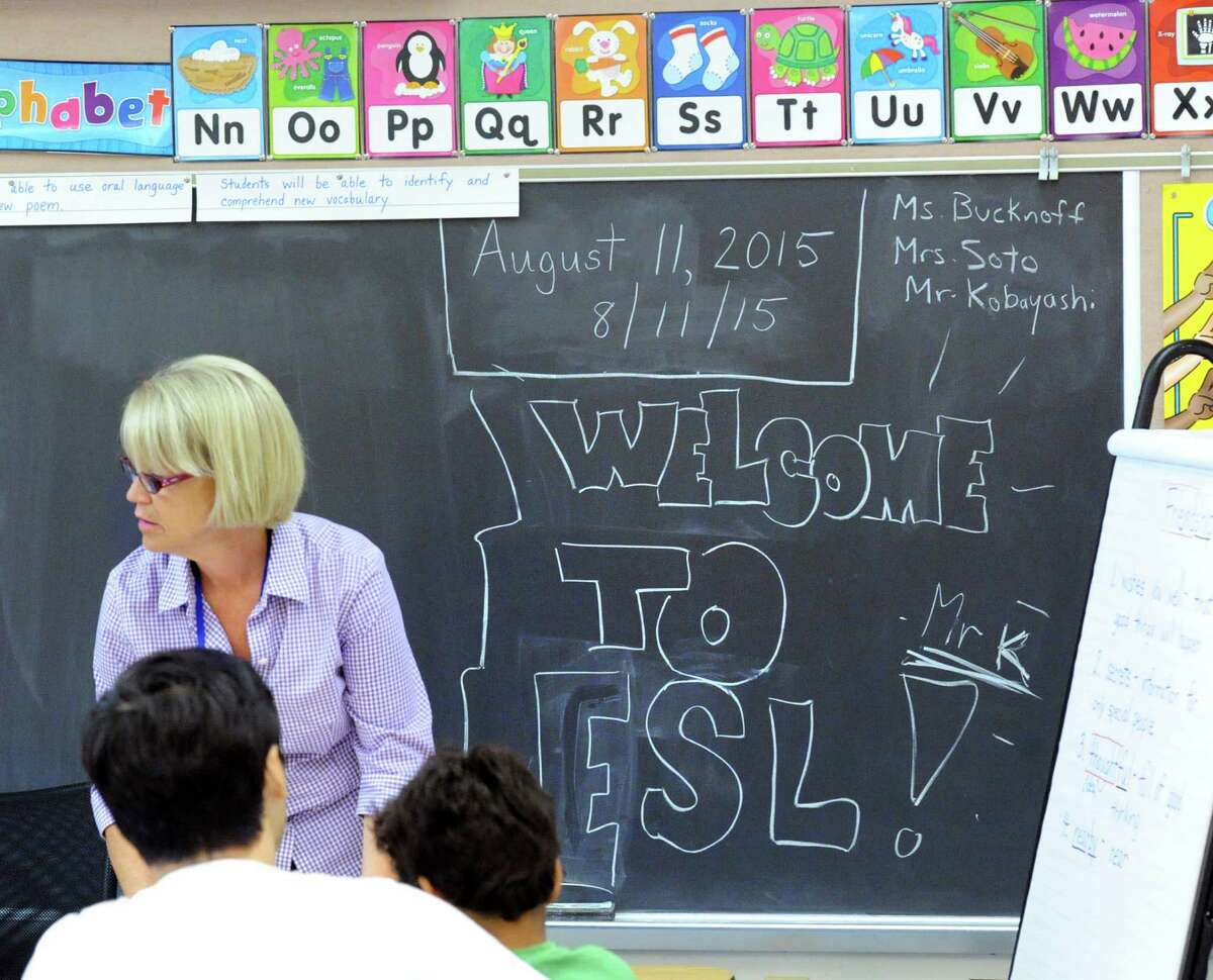 Chris Bucknoff teaches the English as a Second Language class for rising fourth-grade students at the Cos Cob School in Greewich on Tuesday.
