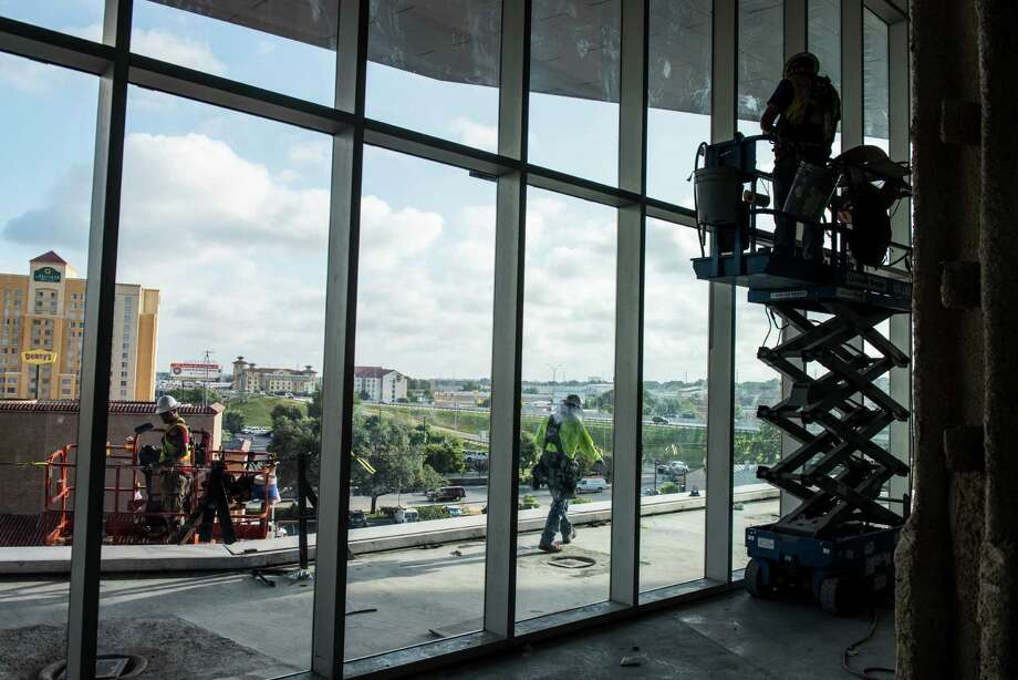Construction workers build a ballroom terrace during construction at the  Convention Center.   Photo: Matthew Busch /For San Antonio Express-News / © Matthew Busch