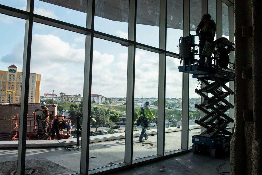 Construction workers build a ballroom terrace during construction at the Convention Center.  Photo: Matthew Busch /For San Antonio Express-News / © Matthew Busch