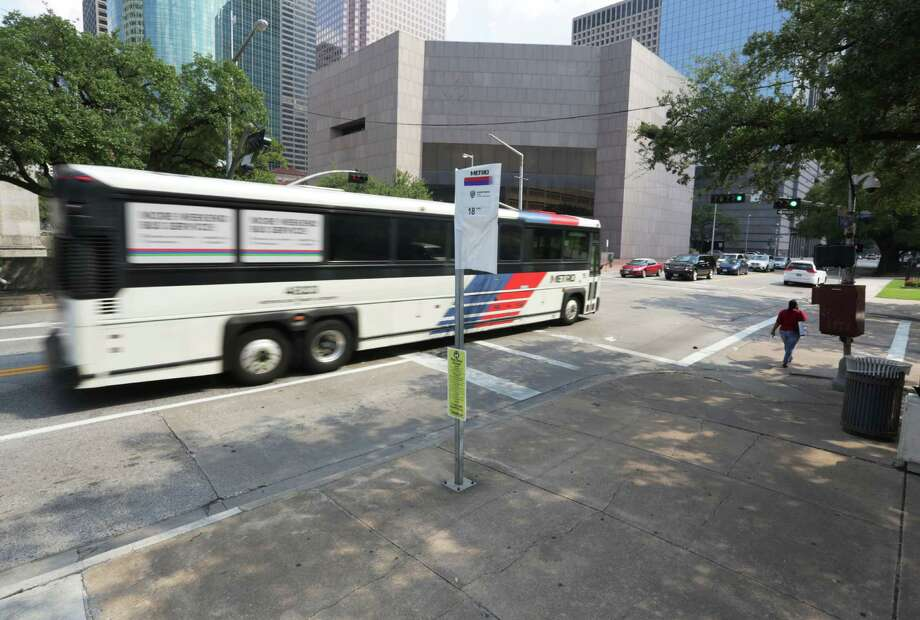 A Metro bus speeds by the stop for the number 18 at McKinney Street and Bagby Street Thursday, Aug. 13, 2015, in Houston. Metro will do away with this route, and a few others, with the upcoming route changes scheduled to begin Sunday. ( Jon Shapley / Houston Chronicle ) Photo: Jon Shapley, Staff / © 2015 Houston Chronicle