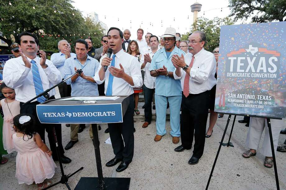 U.S. Rep. Joaquin Castro receives applause after accepting the position of chairman for the upcoming 2016 Texas Democratic State Convention to be held here in San Antonio during a press conference at La Villita on Friday, Aug. 14, 2015. Castro is flanked by Bexar County Democrat Party Chairman Manuel Medina (left) and current Texas Democratic Party Chairman Gilbert Hinojosa. (Kin Man Hui/San Antonio Express-News) Photo: Kin Man Hui /San Antonio Express-News / ©2015 San Antonio Express-News
