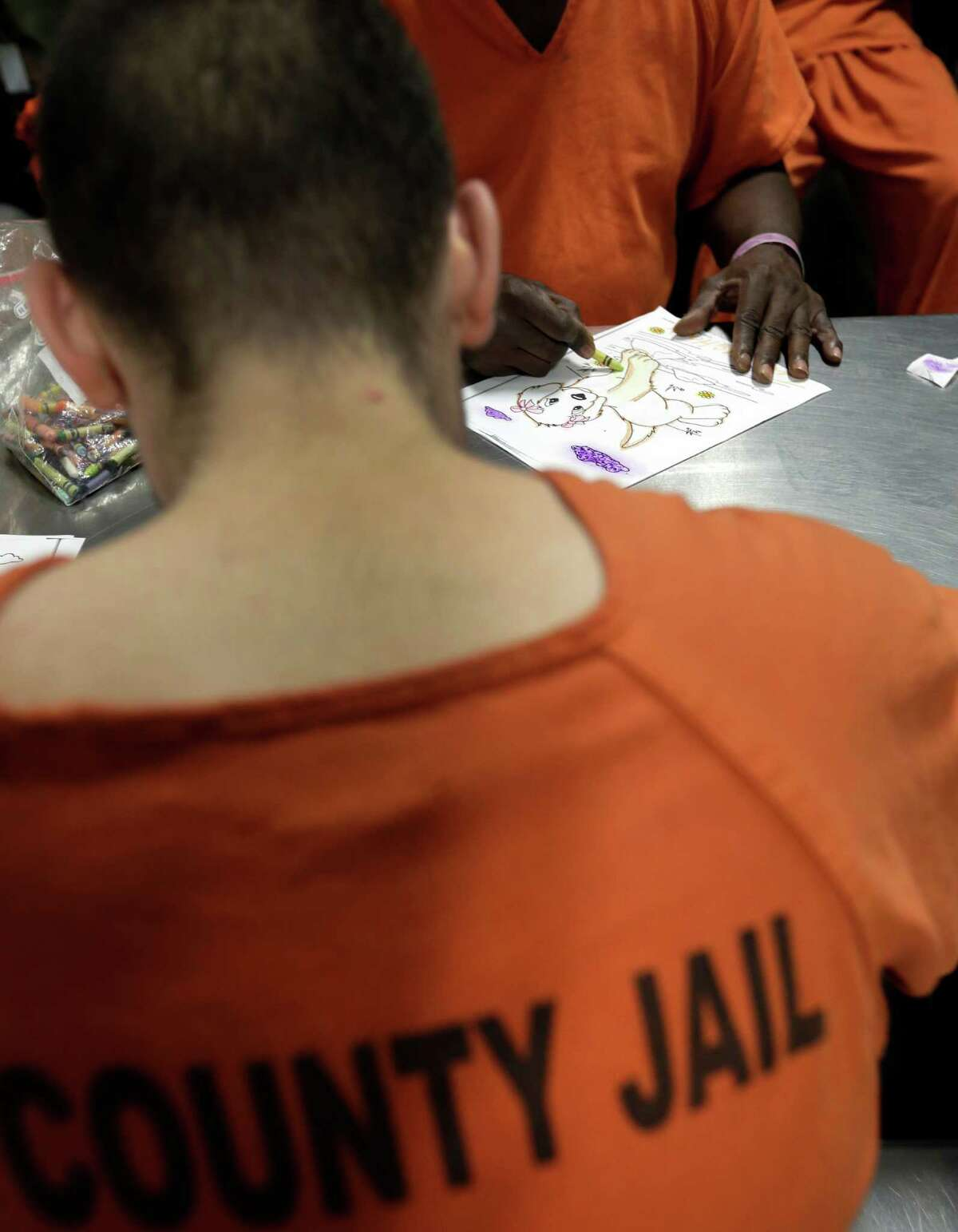 Inmates take part in a group therapy session in an acute unit of the mental heath unit at the Harris County Jail in Houston. (AP Photo/Eric Gay)