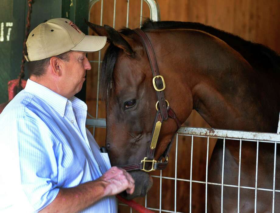 Trainer Dave Donk shares a quiet moment with his charge King Kreesa Friday morning Aug. 14, 2015, who is the morning line favorite in the Fourstardave to be run on Saturday at the Saratoga Race Course in Saratoga Springs, N.Y.     (Skip Dickstein/Times Union) Photo: SKIP DICKSTEIN