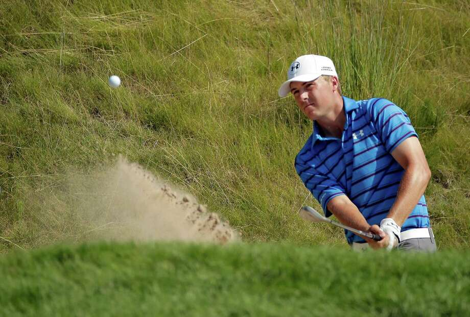 One of the key shots during Jordan Spieth's second-round 67 on Friday was this blast out of the bunker that the Texan holed on No. 18, turning a potential bogey hole into a birdie. Photo: Chris Carlson, STF / AP