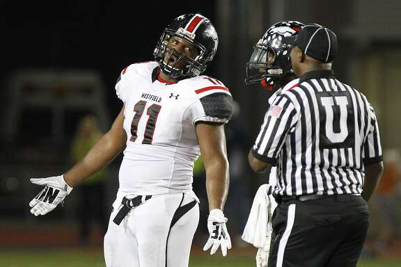 Ed Oliver of Spring Westfield disagrees with an official's call as the Mustangs took on Klein Collins at Klein Memorial Stadium on October 10, 2014.