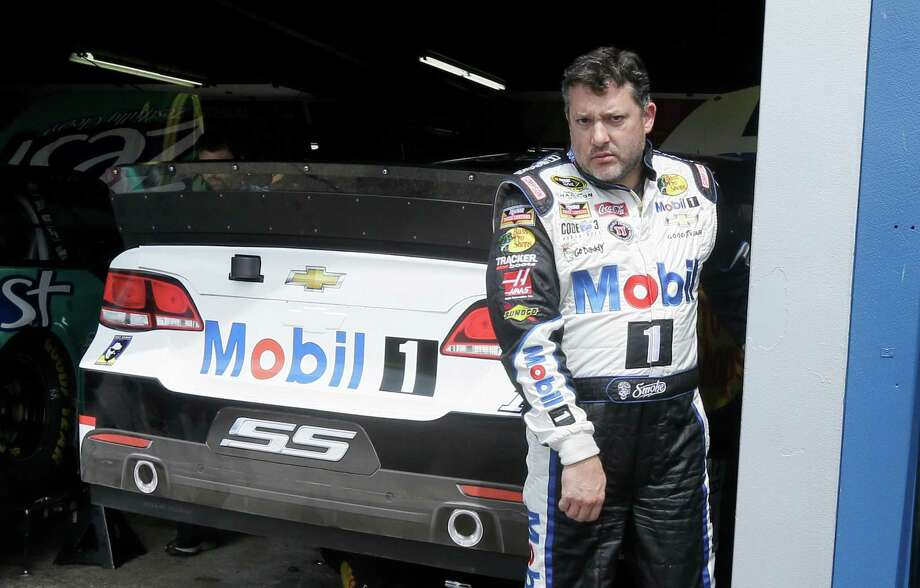 Tony Stewart leaves the garage after a practice session Friday, Aug. 14, 2015, for Sunday's NASCAR Sprint Cup series auto race at Michigan International Speedway in Brooklyn, Mich. (AP Photo/Carlos Osorio) ORG XMIT: MICO102 Photo: Carlos Osorio / AP